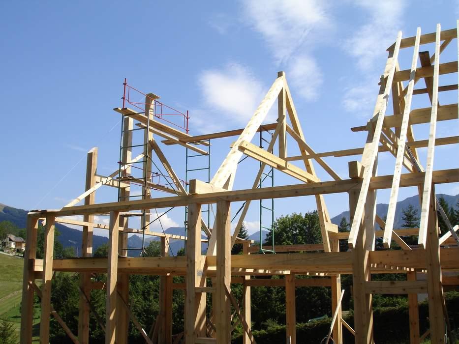 Batiment structure bois trieves maison durand charpente for Batiment structure bois